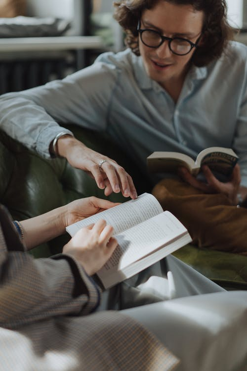 Man in Gray Dress Shirt Reading Book