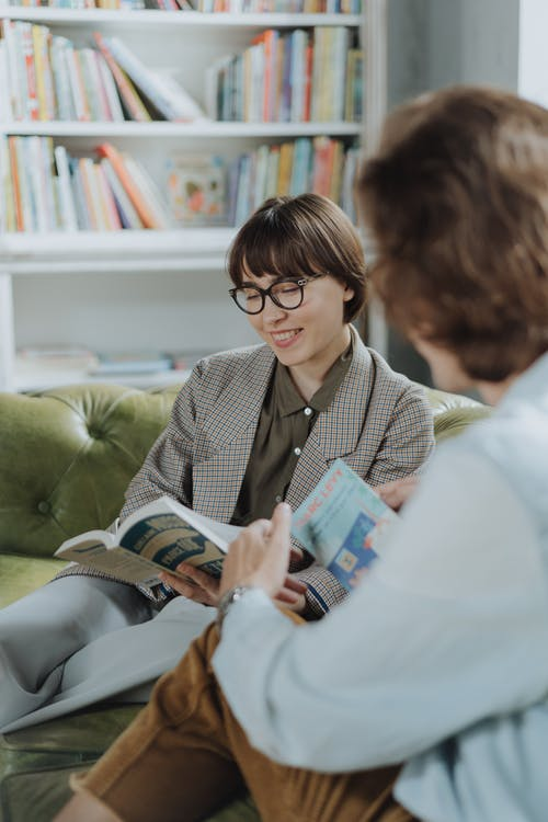 Woman in Gray Blazer Reading Book