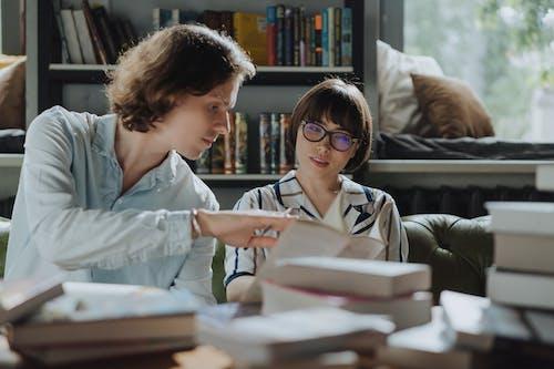 Girl in White School Uniform Reading Book