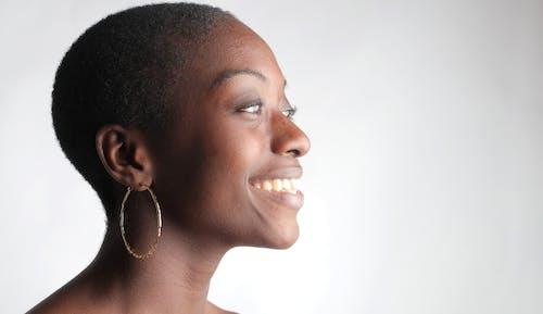 Woman in Silver Earrings Smiling
