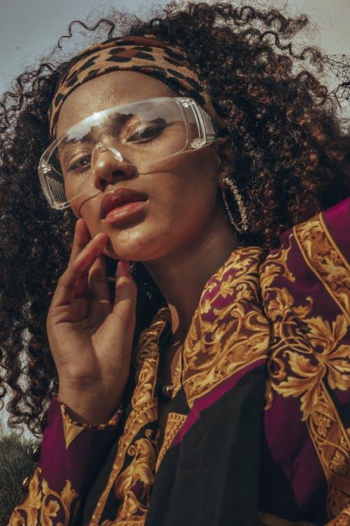 Woman in Gold Framed Eyeglasses
