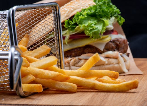 Close Up Photo of Fries and Burger