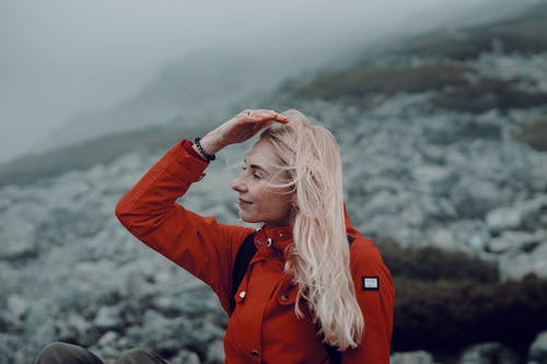Woman in Red Jacket Hiking in Nature