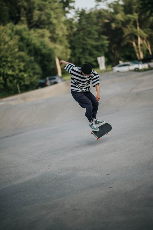 Young man riding skateboard and doing trick