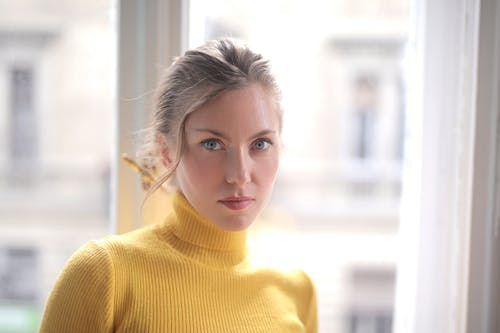 Woman in Yellow Turtleneck Sweater