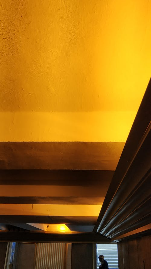 Black Curtain Beside Yellow Wall