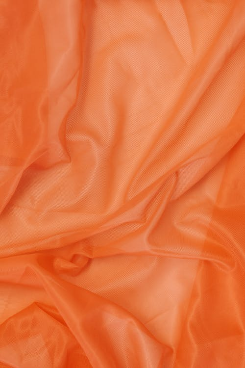 Orange Textile on Brown Wooden Table