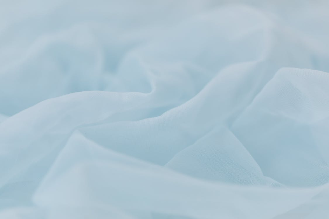 Baby Blue Textile in Close Up Photography
