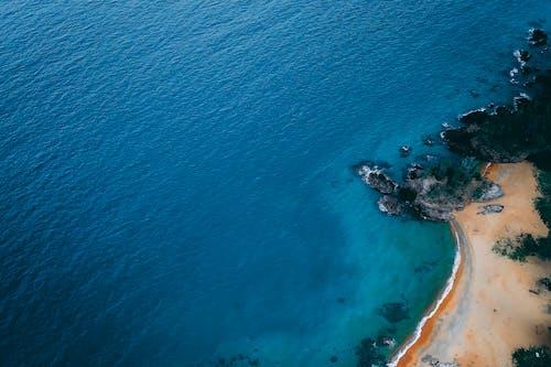 Amazing seascape with sandy coast on sunny day