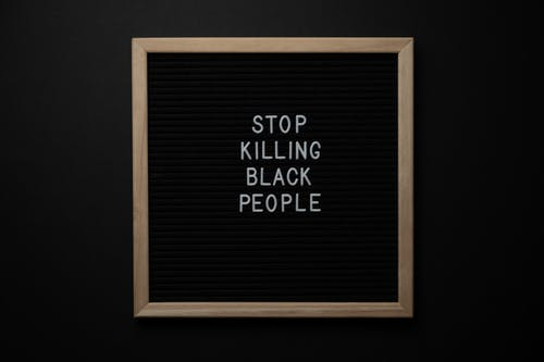 Blackboard with Stop Killing Black People inscription