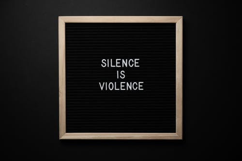 Blackboard with Silence Is Violence title on black background