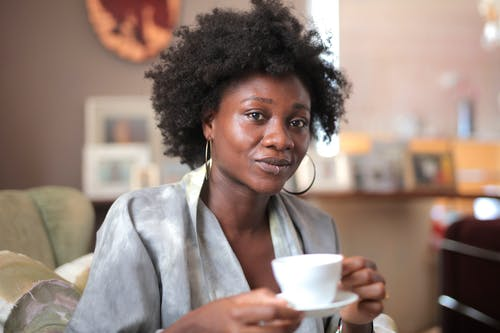 Woman With a Lip Piercing Holding a Ceramic Cup