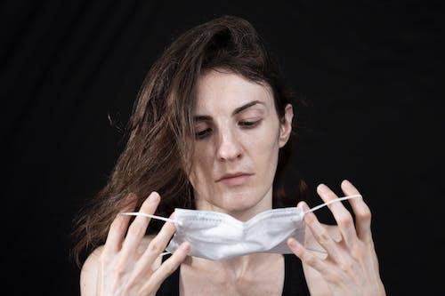 Woman in Black Tank Top Holding White Ribbon