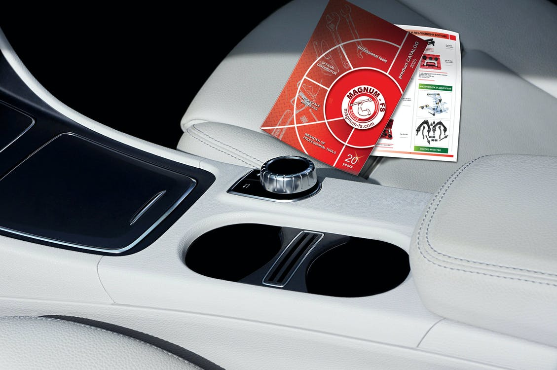Modern car salon with colorful booklets