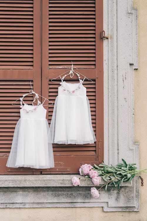 White Spaghetti Strap Dress on Brown Wooden Door