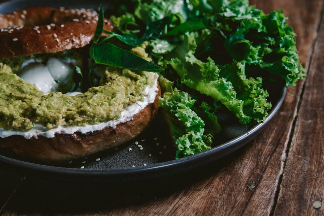 Green Vegetable on Black Ceramic Plate