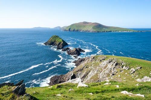 Rocky cliff near blue sea water