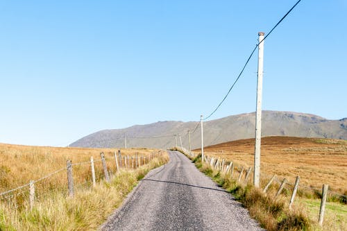 Empty road in countryside near mountains