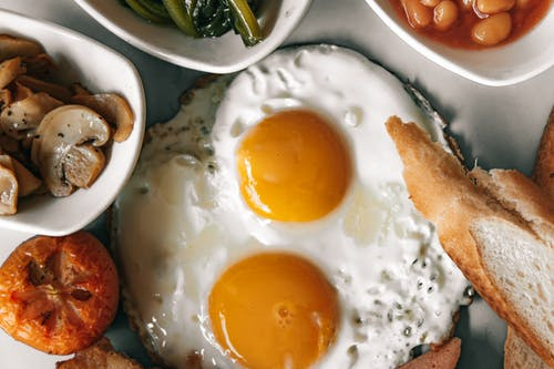 Sunny Side Up Eggs On White Ceramic Plate