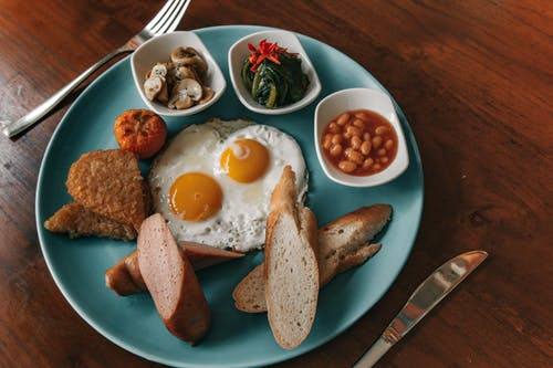 Eggs And Bread On Blue Ceramic Plate