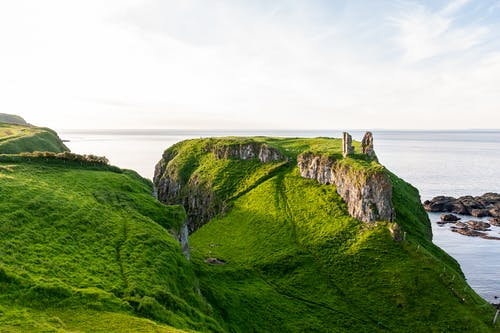 Cliffs with castle remains near sea