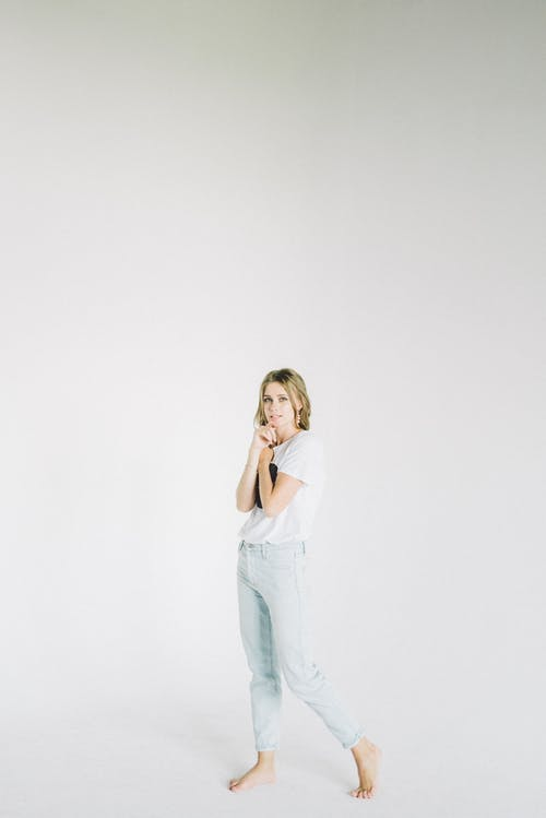 Woman In White Shirt And Blue Denim Jeans