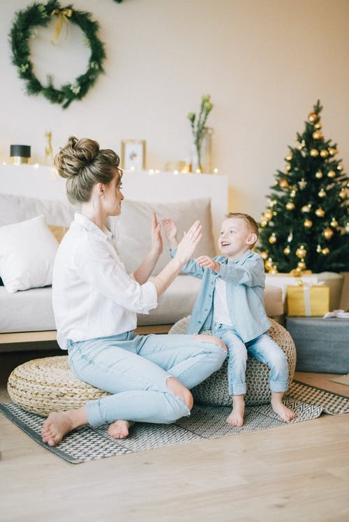 Woman In White Long Sleeve Top Playing With Her Child