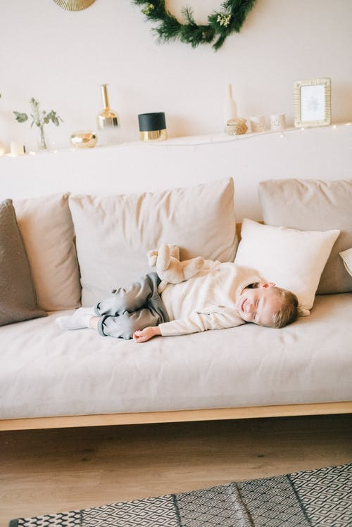 Boy Lying On The Couch