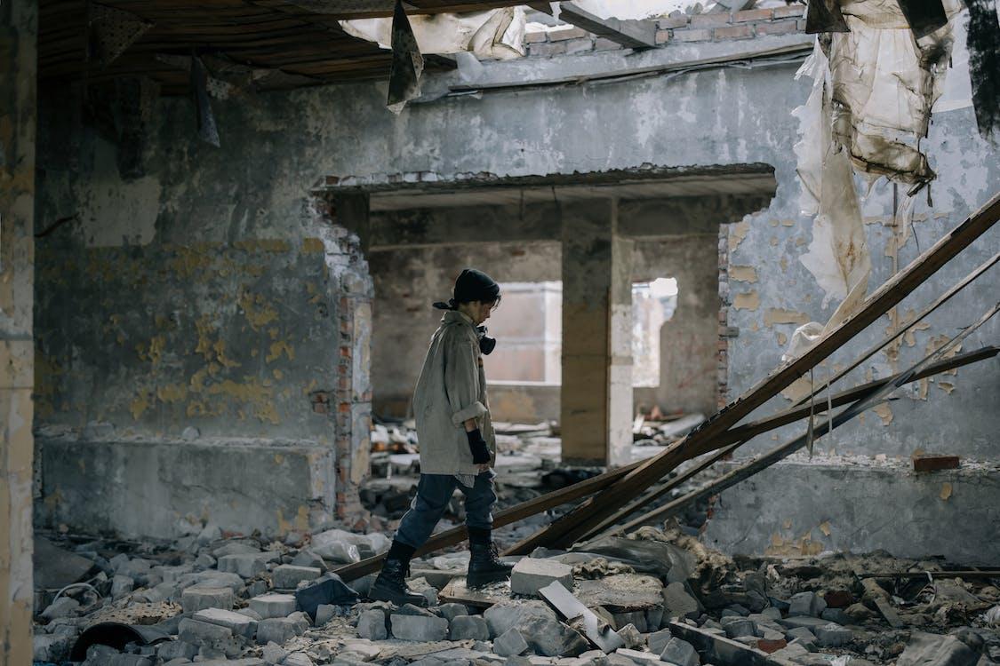 Man in White Jacket Walking on Gray Concrete Stairs