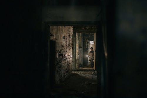 Brown Wooden Door in a Dark Room