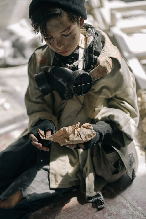 Boy in Brown Jacket Holding Black Dslr Camera