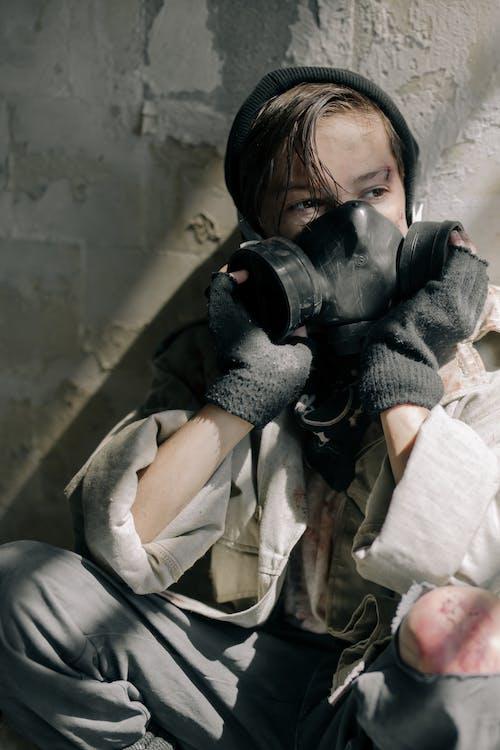 Woman in Gray Jacket and Black Pants Holding Black Binoculars