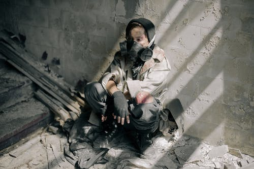 Woman in Black Jacket Sitting on Floor