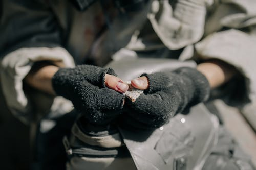 Person in Black Knit Gloves