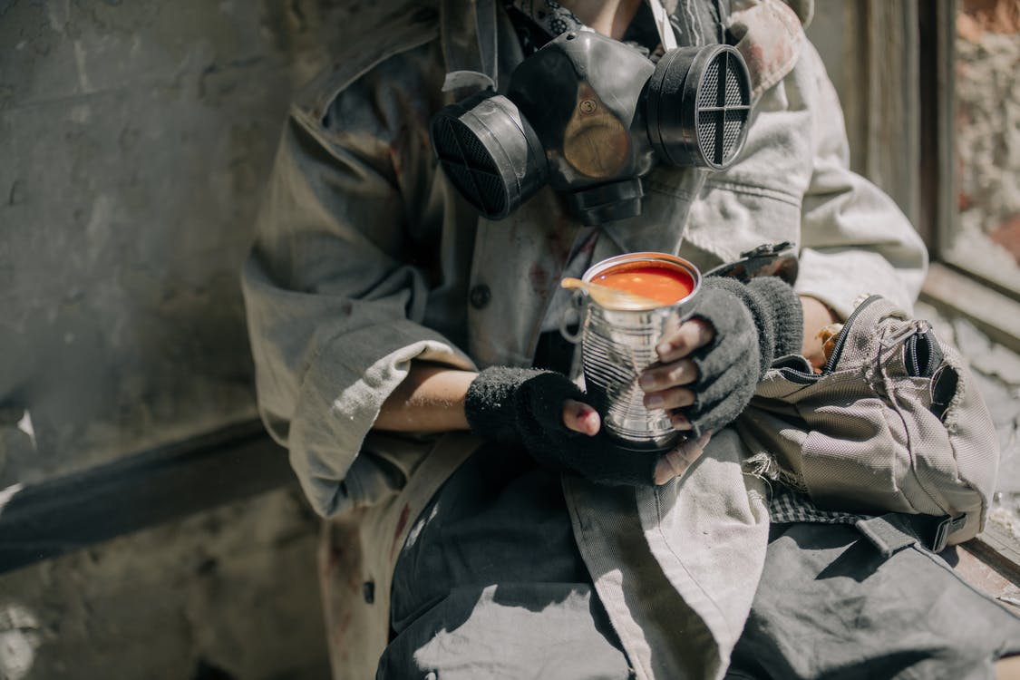 Person in Gray Jacket Holding White and Red Ceramic Mug