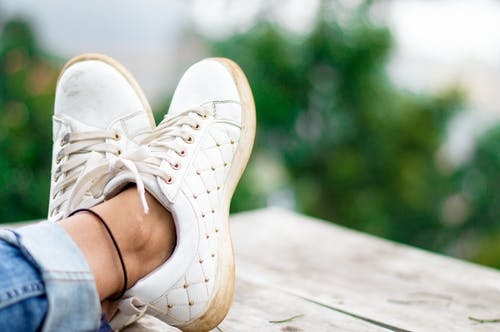 Close Up of White Low Top Sneakers