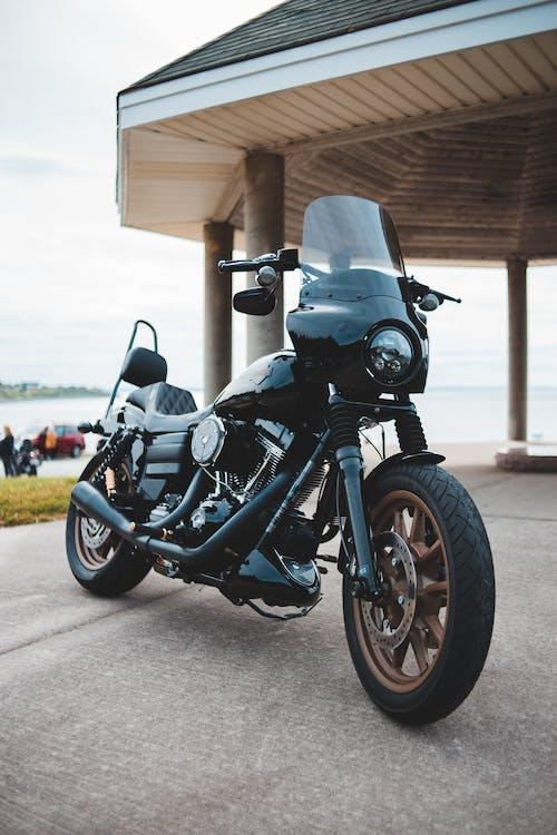 Classical black motorbike on pavement by rotunda