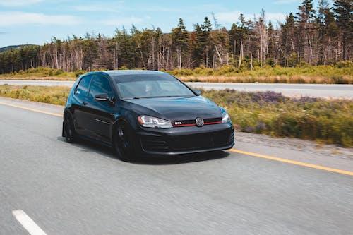 Black sports car on highway