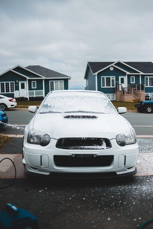 Car front side in soap
