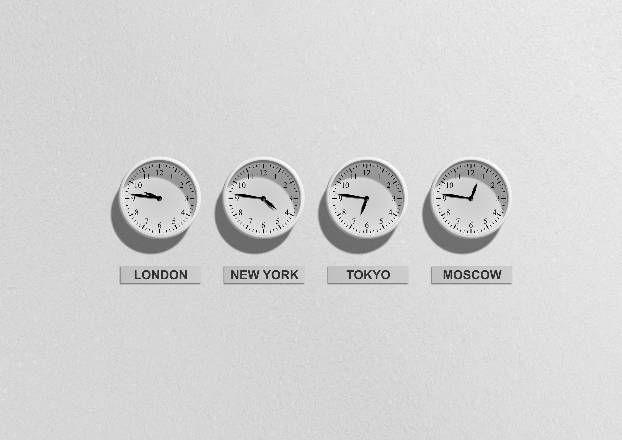 Image of four clocks set to different time zones, depicting customer expectations of 24/7 service.