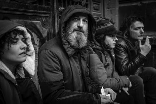 Man In Black Jacket In Grayscale Photography
