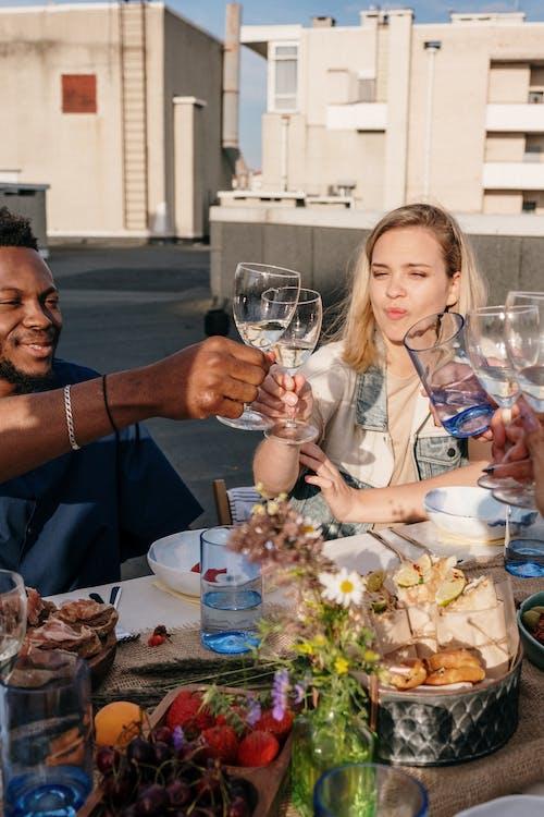 Woman in White Blazer Holding Wine Glass