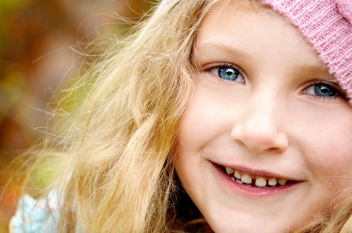 Blond Haired Girl Wearing Pink Knitted Cap