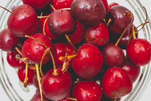 Red Cherry Fruits In Close Up Photography