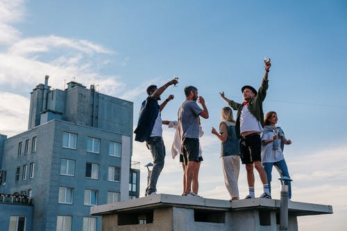 Group of People Standing on Top of Building