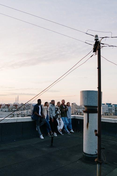 People Standing on the Bridge