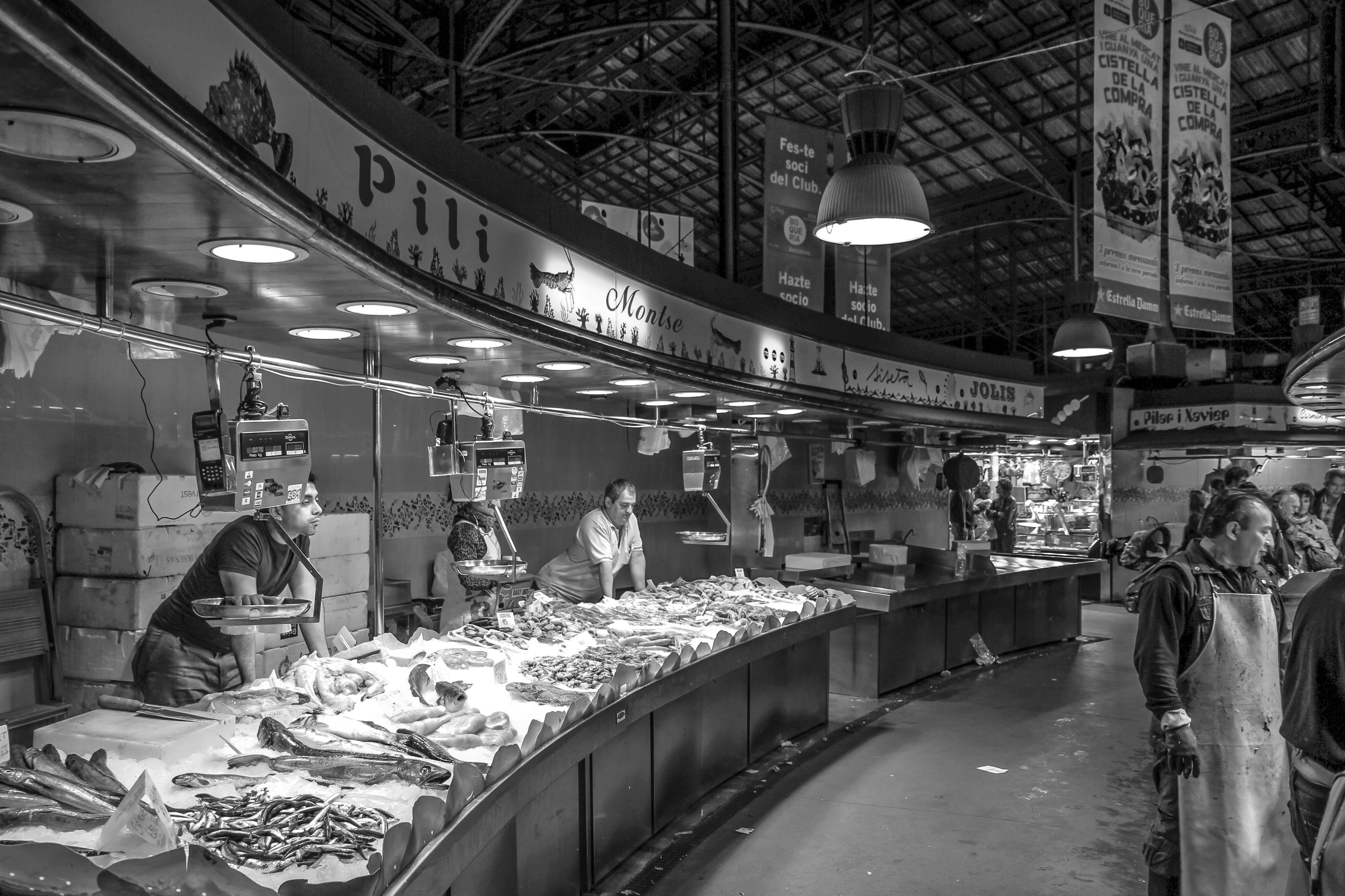Gray Scale Photo of a People in Market
