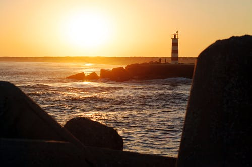 Gratis stockfoto met strand, vuurtoren, zonsondergang