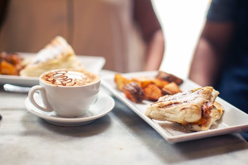 Grilled sandwich and sweet potato served with aromatic cappuccino