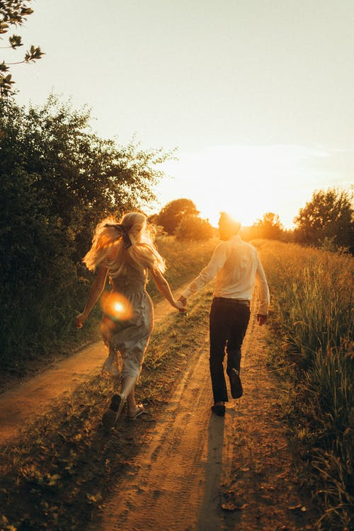 Couple Running while Holding Hands